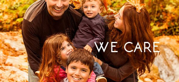 family in fall leaves with we care words