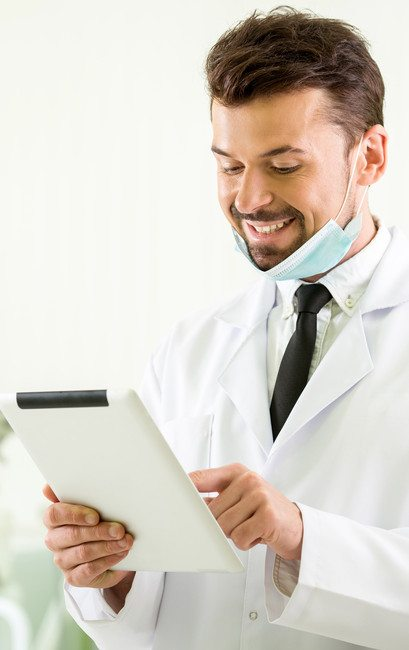 dentist looking at responsive website on tablet