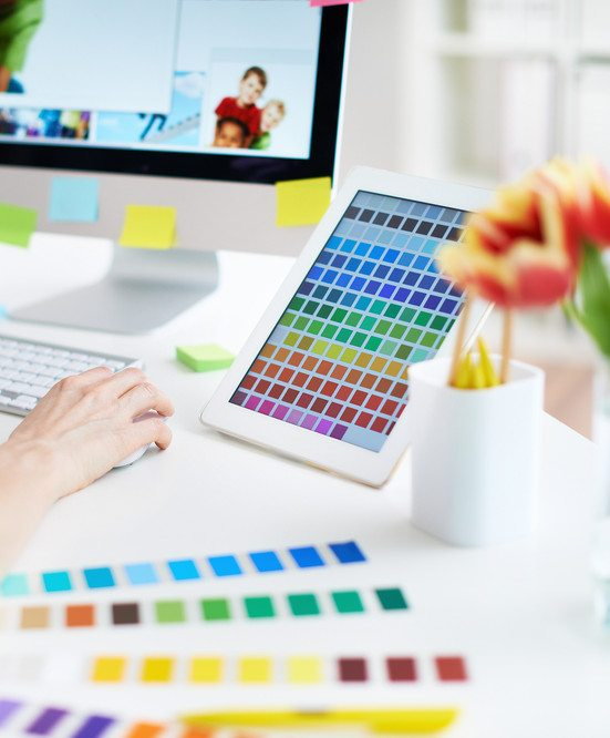 graphic designers desk with color samples