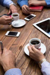 business people with smartphones and tablets