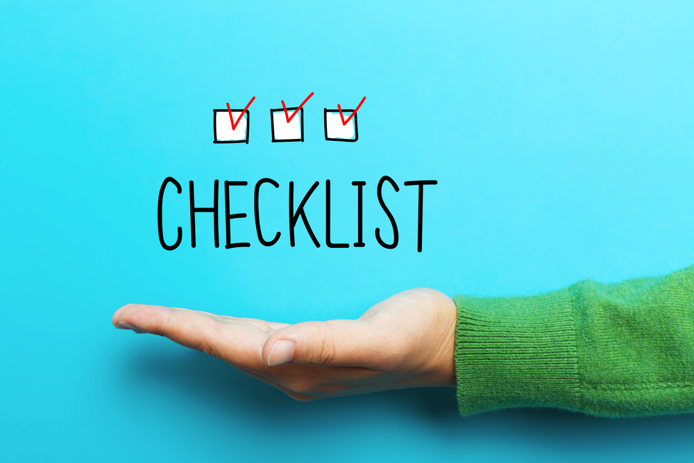 Checklist concept with hand