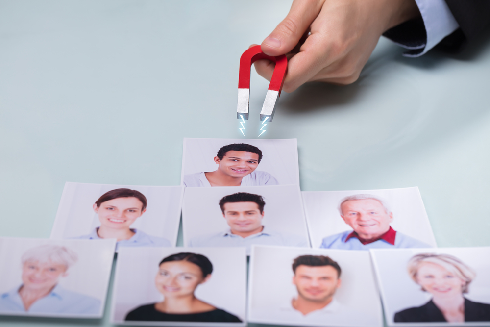magnet attracting pictures of smiling dental patients
